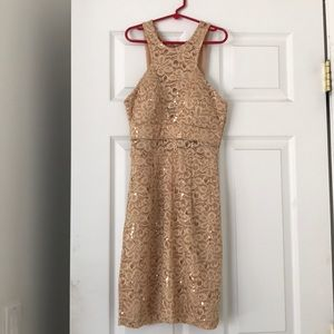 This cute gold mini dress, only worn once!